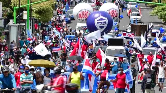 san jose residents take to the streets to protest against the temporary taxes and a new public employment bill introduced by the costa rican... - costa rica stock videos & royalty-free footage