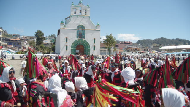 san juan chamula carnival. people with traditional costume dancing at the church square. famous place because of the syncretic religion - 16th century style stock videos & royalty-free footage