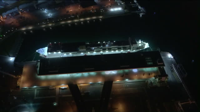 san pedro, ca, u.s. - aerial night view of usns mercy hospital ship moored in port of los angeles during covid-19 pandemic, on wednesday, april 1,... - american red cross stock videos & royalty-free footage