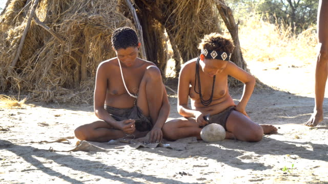 san people of namibia (bushmen) , daily life - shirtless stock videos and b-roll footage
