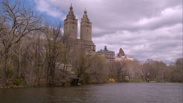 san remo overlooking the lake in central park on a spring day - upper west side manhattan stock videos and b-roll footage