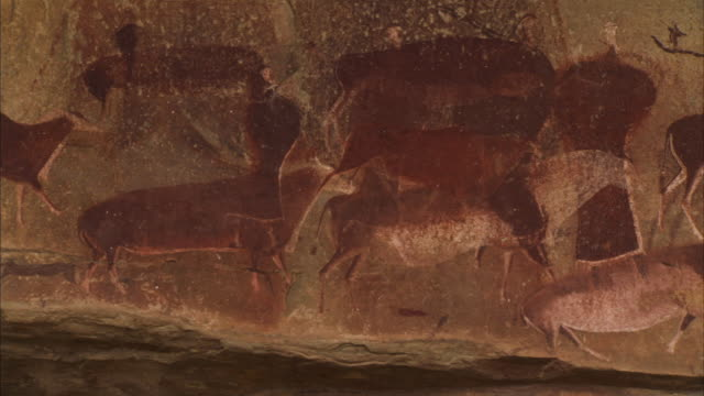 a san rock painting features a man with animals in the drakensberg mountains of south africa. available in hd - drakensberg mountain range stock videos & royalty-free footage