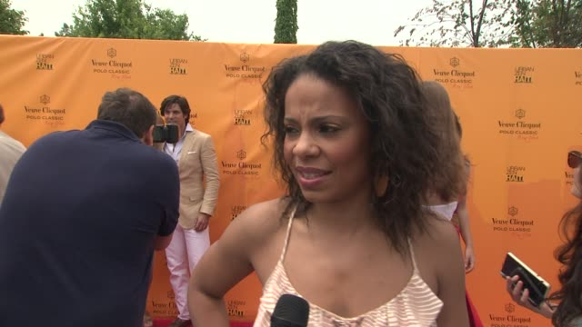 Sanaa Lathan talks about what bought her out today Happy to be on Governors Island at the The Fourth Annual Veuve Clicquot Polo Classic at New York NY