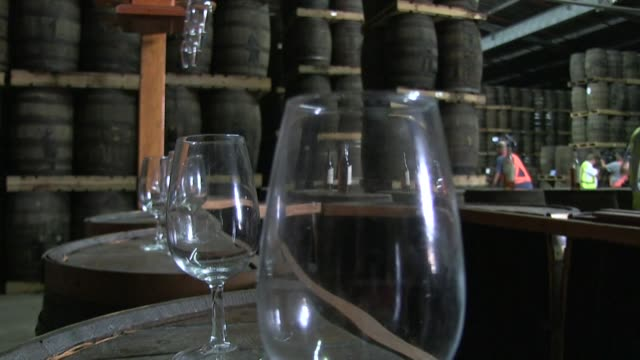 us sanctions against cuba have made life tough for producers of the island's signature alcoholic drink rum but despite running a gauntlket of... - distillery still stock videos & royalty-free footage