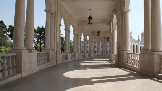 vídeos de stock e filmes b-roll de sanctuary of the virgin of fatima, colonnaded gallery - portugal