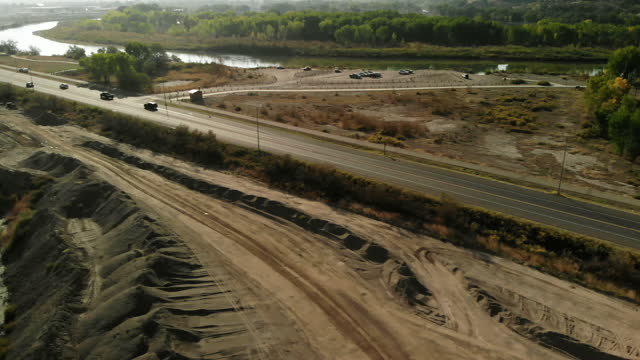 sand and gravel pit heavy equipment and construction site industrial 4k drone areal video series - bulldozer stock videos & royalty-free footage