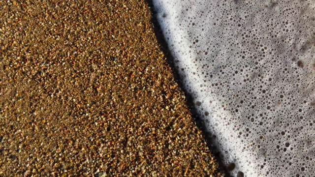 Sand and sea waves