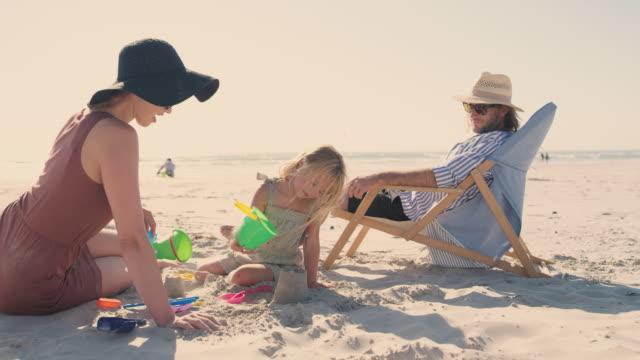 sand and sun, summer has begun! - deckchair stock videos & royalty-free footage