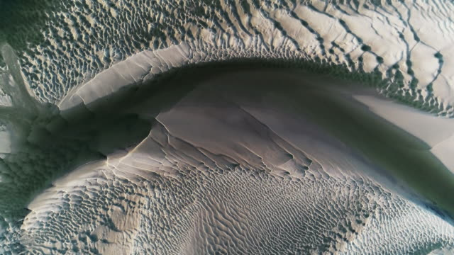 sand and water patterns at low tide filmed by drone, borth-y-gest, wales, united kingdom - low tide stock videos & royalty-free footage