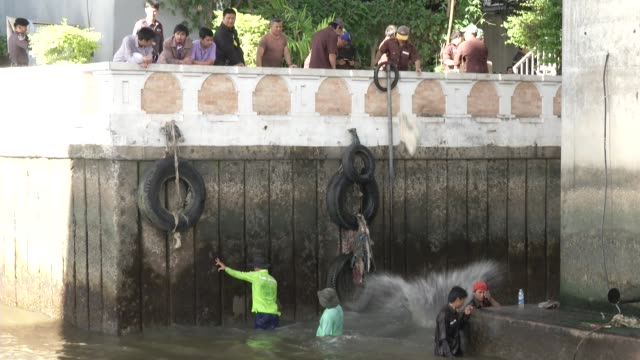 sand bags are thrown into a canal during an investigation of a bomb thrown in a canal inlet near the saphan thaksin bts and river they prepare to... - inlet stock videos & royalty-free footage