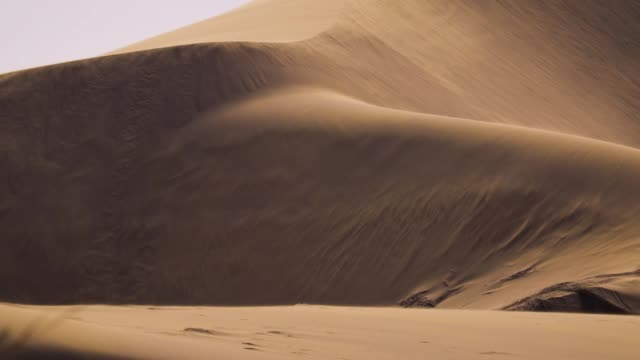 sand blowing over the dunes, slowmotion - arid stock videos & royalty-free footage