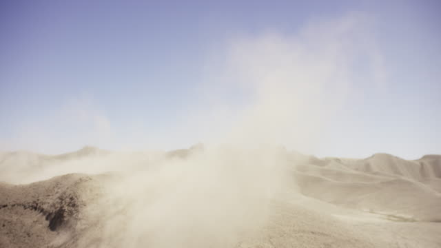 Sand blows in the wind in desert, slow motion