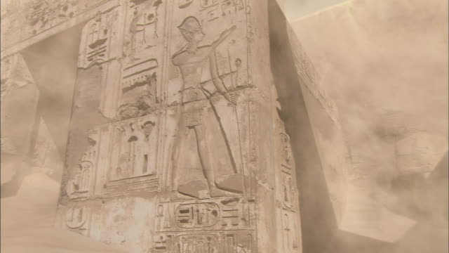 sand blows through ancient egyptian ruins. - hieroglyph stock videos & royalty-free footage