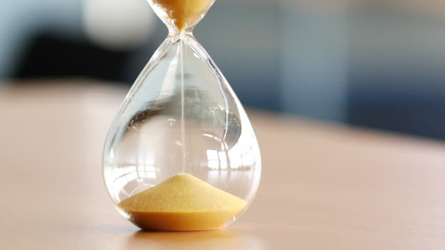 4k sand clock, business time management concept - timer stock videos & royalty-free footage