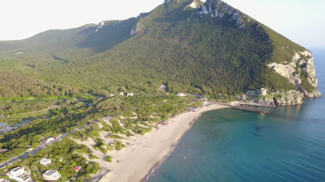 sand dune in sabaudia and luxury villas on the beach - drone view - südamerika stock-videos und b-roll-filmmaterial