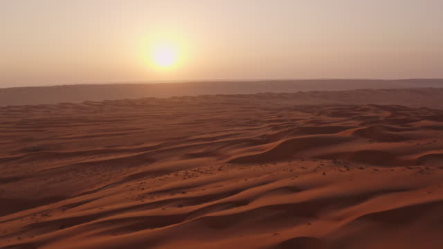 aerial sand dunes at sunset - desert stock videos & royalty-free footage