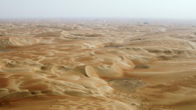 sand dunes in arabian desert uae - barren stock videos & royalty-free footage