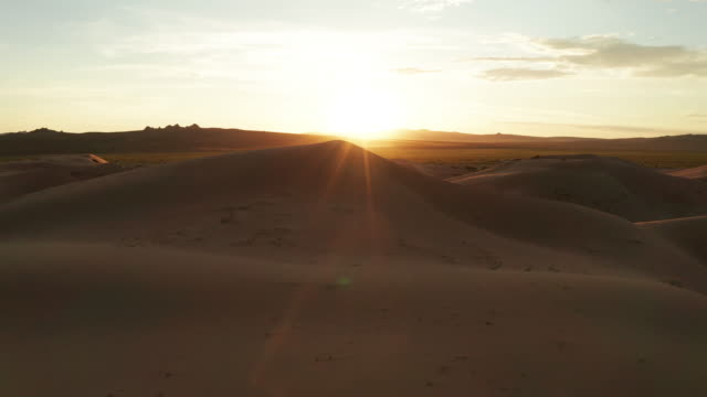 sand dunes in the desert at sunset. aerial view - desert stock videos & royalty-free footage