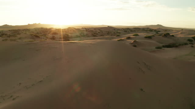 sand dunes in the desert at sunset. aerial view - arid stock videos & royalty-free footage