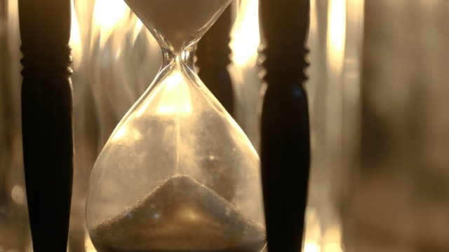 sand falling in hourglass - hourglass stock videos & royalty-free footage
