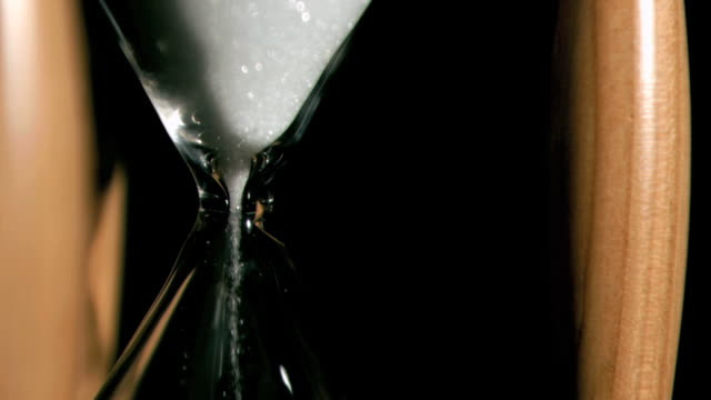 Sand falling in super slow motion from a hourglass