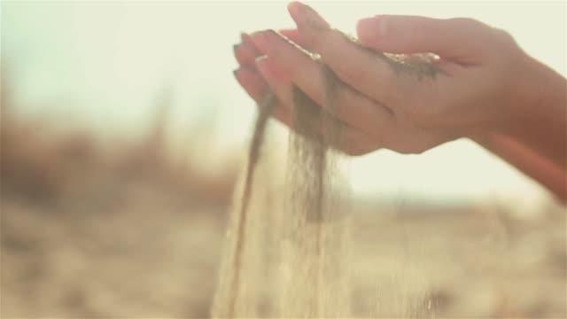 sand falling through fingers