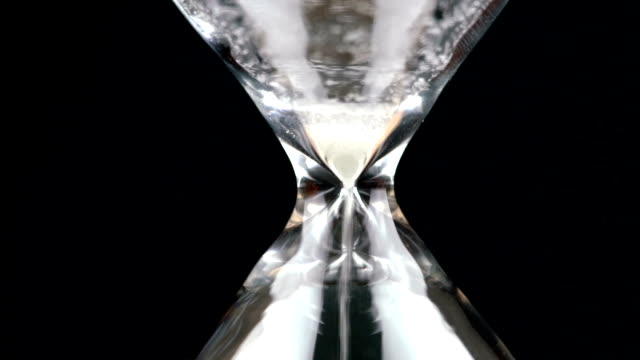 sand in hourglass is empty. time concept - timer stock videos and b-roll footage