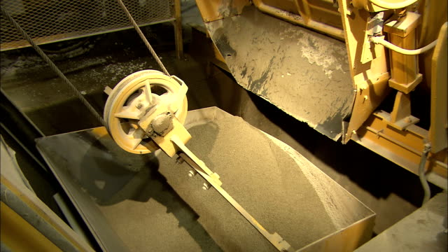 sand partially fills a large bucket in a cement factory. - cement mixer stock videos & royalty-free footage