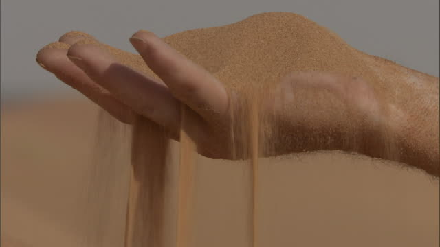 sand sifts through fingers. - finger stock videos & royalty-free footage
