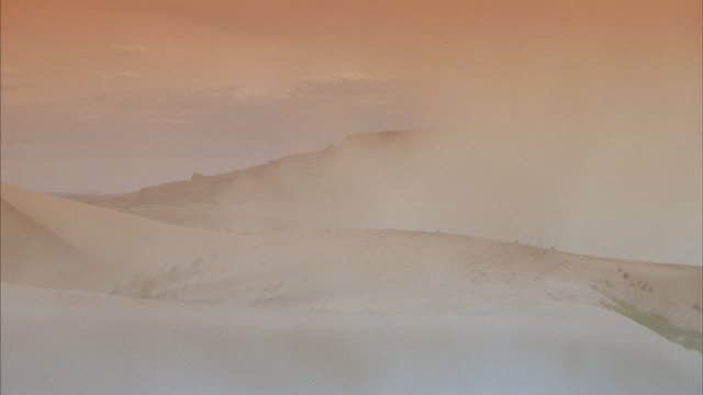 a sand storm blows over dunes in the desert. - sandy utah stock videos and b-roll footage
