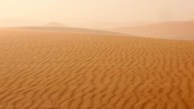 Sand storm, Erg-Chigaga sand dunes. Sahara Desert, Mhamid, Morocco