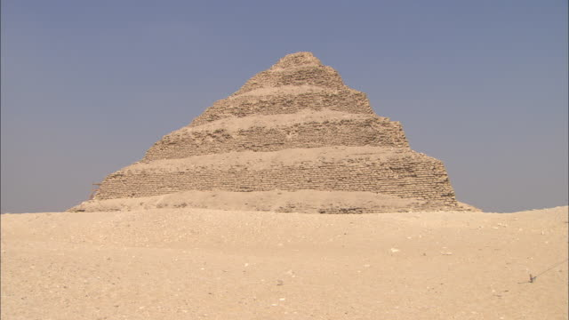 Sand surrounds the ancient Saqqara Pyramid in Egypt.