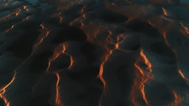 vidéos et rushes de sand textures in an estuary at low tide filmed by drone, borth-y-gest, wales, united kingdom - land