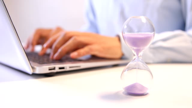 Sand timer with person working