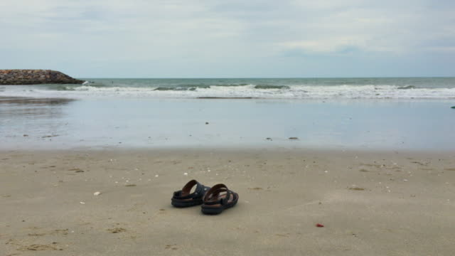 sandals on the beach,steadicam shot - slipper stock videos and b-roll footage