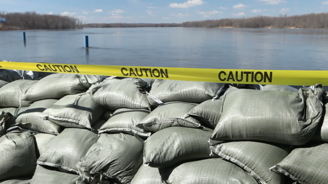 sandbag wall holding back the mississippi river - sandbag stock videos and b-roll footage