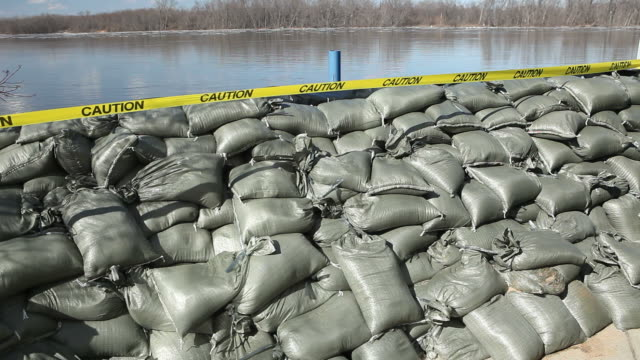 sandbag wall holding back the mississippi river - levee stock videos & royalty-free footage