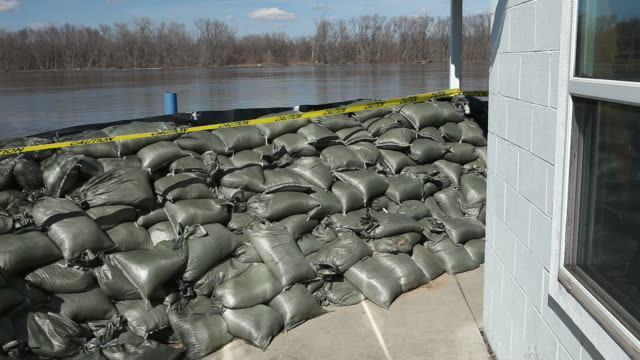 sandbag wall prepared for a major river flood - sandbag stock videos and b-roll footage