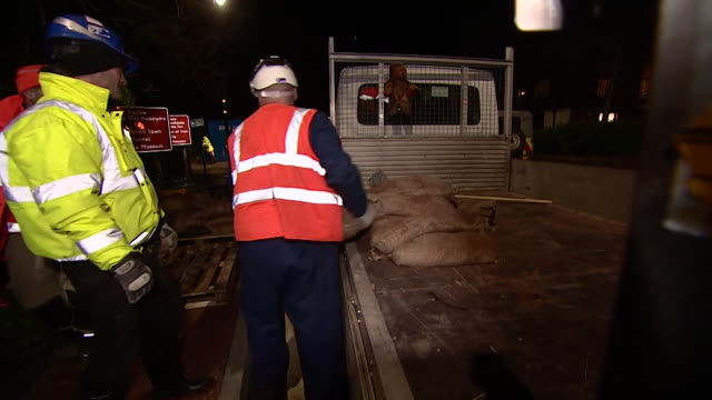 sandbags being laid in ironbridge to protect it from flooding from the river severn - emergencies and disasters stock videos & royalty-free footage