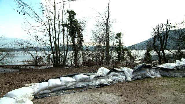 sandbags on the shore of a river - sandbag stock videos & royalty-free footage