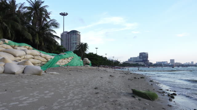 sandbags protect erosion along the pattaya beach, chonburi, thailand. - sandbag stock videos and b-roll footage