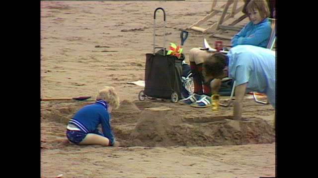 sandcastles being built on a sandy beach; 1978 - somerset england stock videos & royalty-free footage
