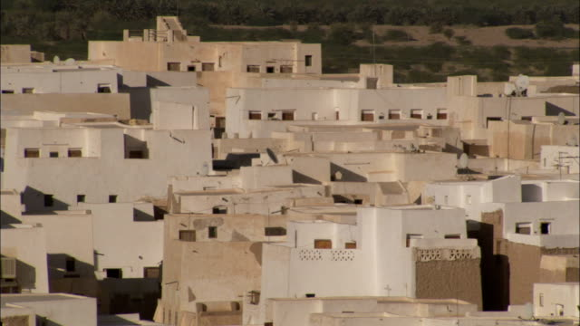 Sand-colored mud-brick rooftops overlook the city of Shibam in Yemen.