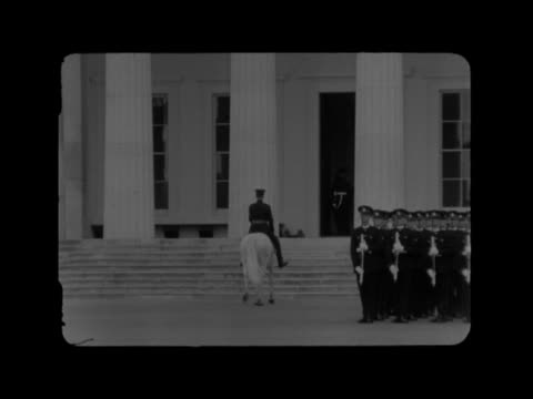 sandhurst sovereign's parade:; england: sandhurst: ext cms field marshal bernard montgomery inspects cadets r-l crowd standard carried in slow march... - cadet stock videos & royalty-free footage