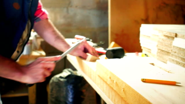 sanding a piece of wood. - grinding stock videos and b-roll footage