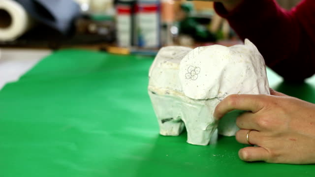 sanding down elephant paper mache sculpture - papier stock videos & royalty-free footage