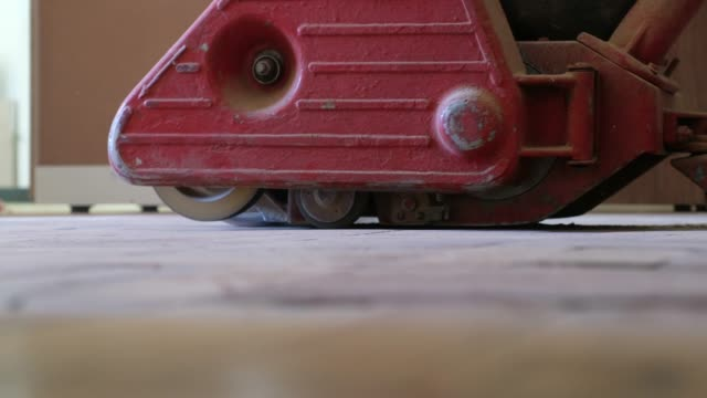 sanding machine sands down some wooden flooring - sander stock videos and b-roll footage
