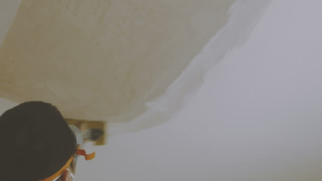 sanding plaster of ceiling - sand paper stock videos and b-roll footage