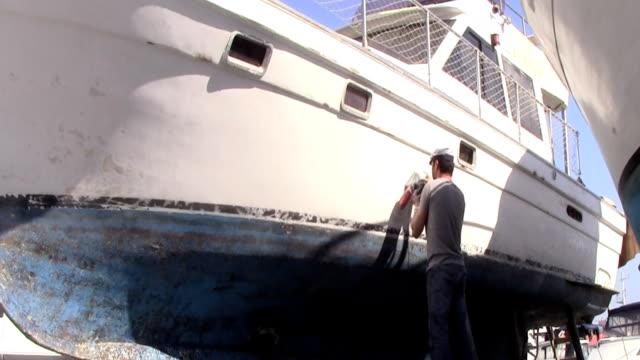 sanding the boat