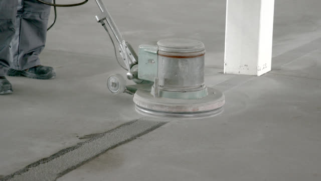 sanding the edges on concrete floor - flooring stock videos & royalty-free footage
